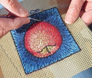 Fiber Artist Laura Gaskin embroiders a stitched painting